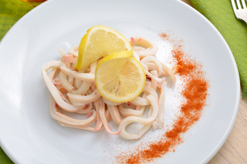 Boiled squid with a lemon
