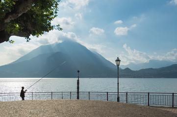 Harbor of Varenna at Lake Como with Fisherman
