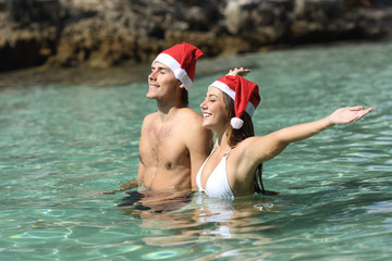 Couple bathing on the beach on christmas holidays