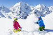 Ski, skier, winter fun - skiers enjoying winter vacation