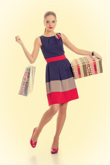 girl with a gift box and shopping bag