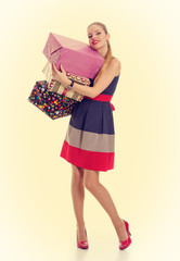 Pretty girl holding a gift box. PinUp style.