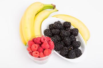 Raspberries Blackberries and Bananas on White