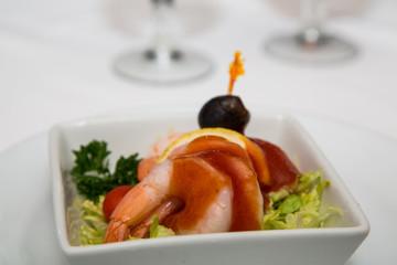Shrimp Cocktail Garnished with Black Olive