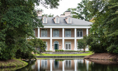 Plaster Mansion with Columns and Reflection in Lake