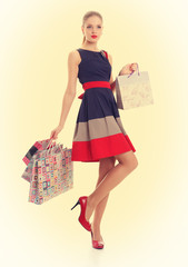 Beautiful girl with shopping bags. Pin-up style.