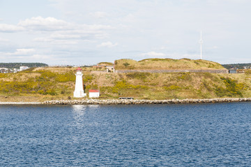 White Lighthouse Over Blue Water