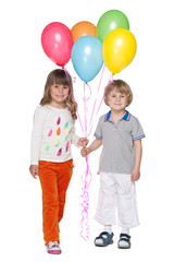 Happy little boy and girl with balloons
