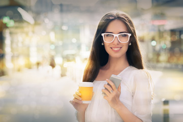Young woman with glasses out in the city