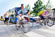 Motion blurred bicyclists in traffic - 71531619
