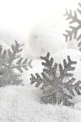 Christmas snowflakes on white snowy background