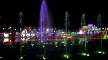 Beautiful night fountain with colored backlight