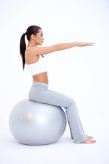 Sexy Fit Woman Sitting on Big Exercise Ball