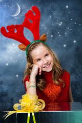 Cute girl wearing rain deer christmas costume.