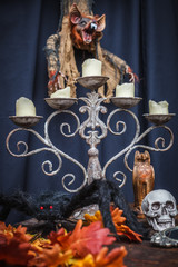 Spider, autumn oak leaves, chandelier, totem skull and vampire