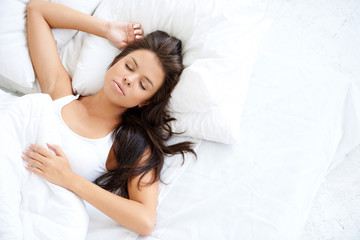 Pretty Young Woman Sleeping on White Bed
