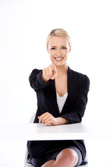 Corporate woman pointing her finger