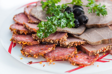smoked pork with olives and herbs