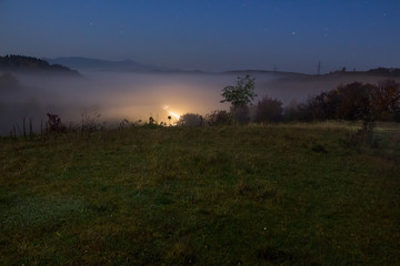 cold fog before sunrise in mountains
