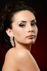 The beautiful woman in jewelry earrings