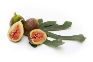 Figs with fig's leaves isolated on white