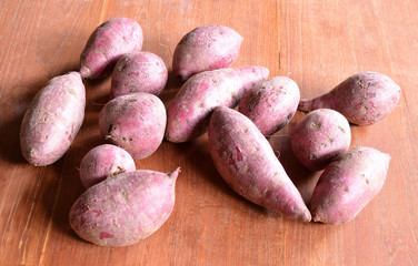 Purple Colored Sweet Potatoes on wood backgrond