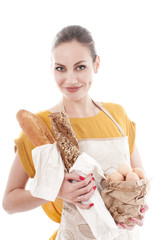 Pretty woman holding bowl with chicken eggs and baguette , over