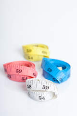 four roll of colorful measuring tapes