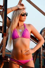 Beautiful young Sexy woman standing in pink bikini