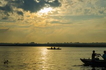 boat sailors at sunrise sunset