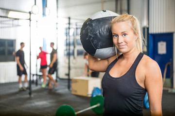 Woman Carrying Medicine Ball At Crossfit Gym