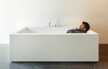 Interior, white bathtub with man
