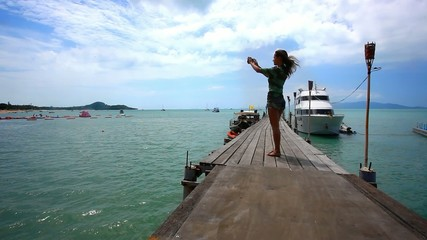 Woman take a picture from bridge of nature on the island Koh