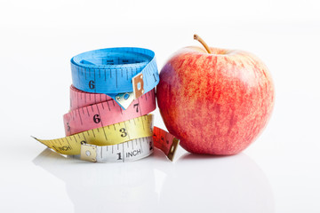 Four color measuring tapes with red apple