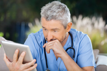 Male Doctor Using Tablet PC