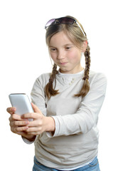 a young girl with a mobile phone