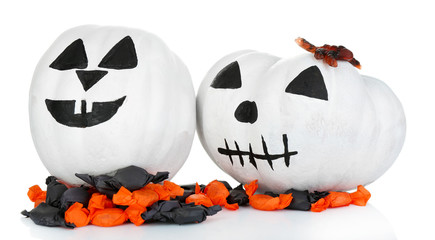 White Halloween pumpkins and candies, isolated on white