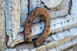 canvas print picture - Old horse shoe on vintage wooden door, outdoors