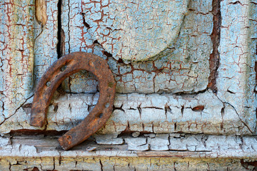 Old horse shoe on vintage wooden door, outdoors