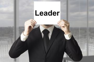 businessman hiding face leader
