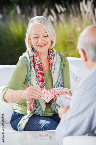 canvas print picture Happy Senior Woman Playing Cards With Man