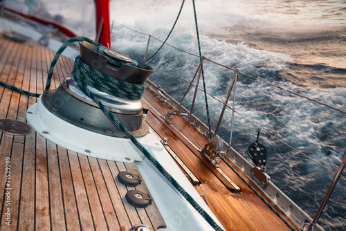 sail boat under the storm, detail on the winch - 71539289