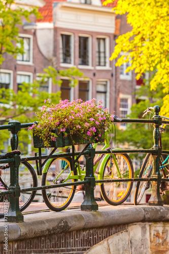 Zdjęcia na płótnie, fototapety na wymiar, obrazy na ścianę : Summer view of bicycles in the Dutch city Amsterdam