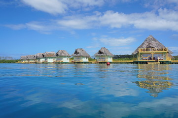 Tropical hut over water with thatched roof Panama
