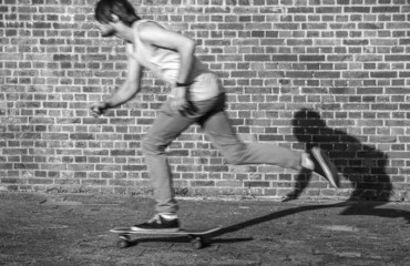 Skateboarder at speed through the city
