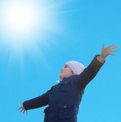 Happy little girl on blue sky  background