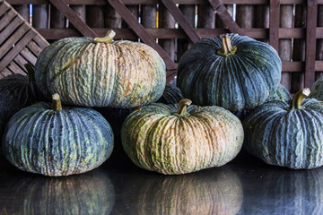 Still life pumpkins with wood background