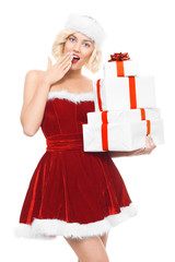 Beautiful yound blond woman as santa girl with gifts