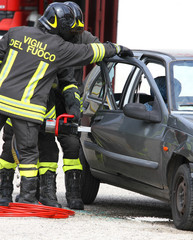 Firefighters open the door of the car with a powerful shears