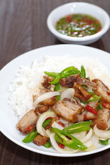 fried basil leaf with crispy pork and rice